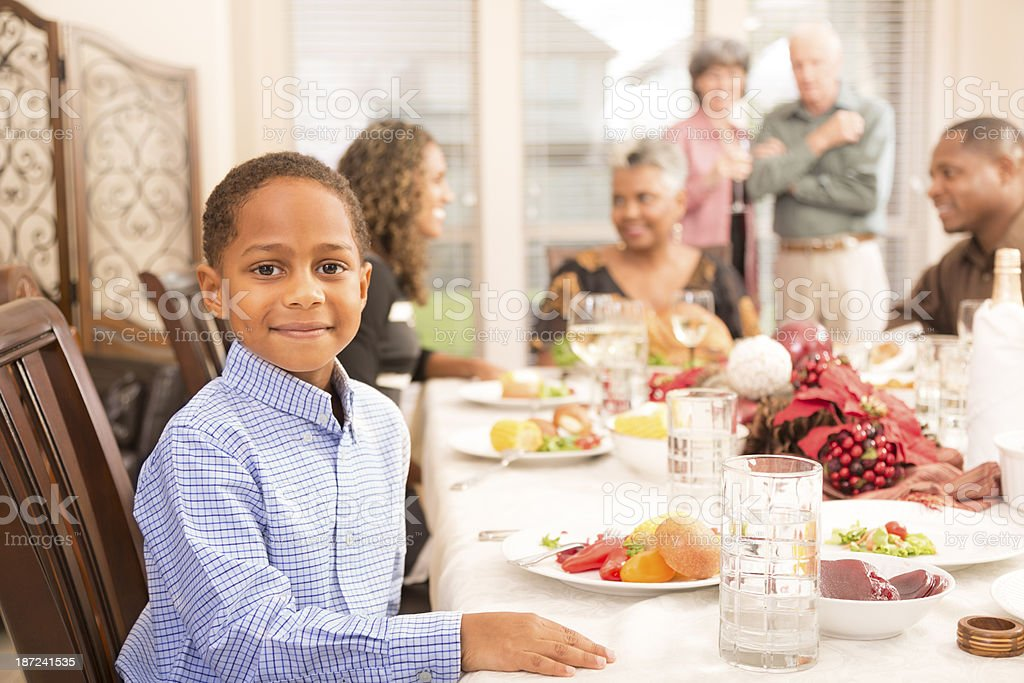 Christmas: Family and friends gather for dinner at grandma's house. royalty-free stock photo
