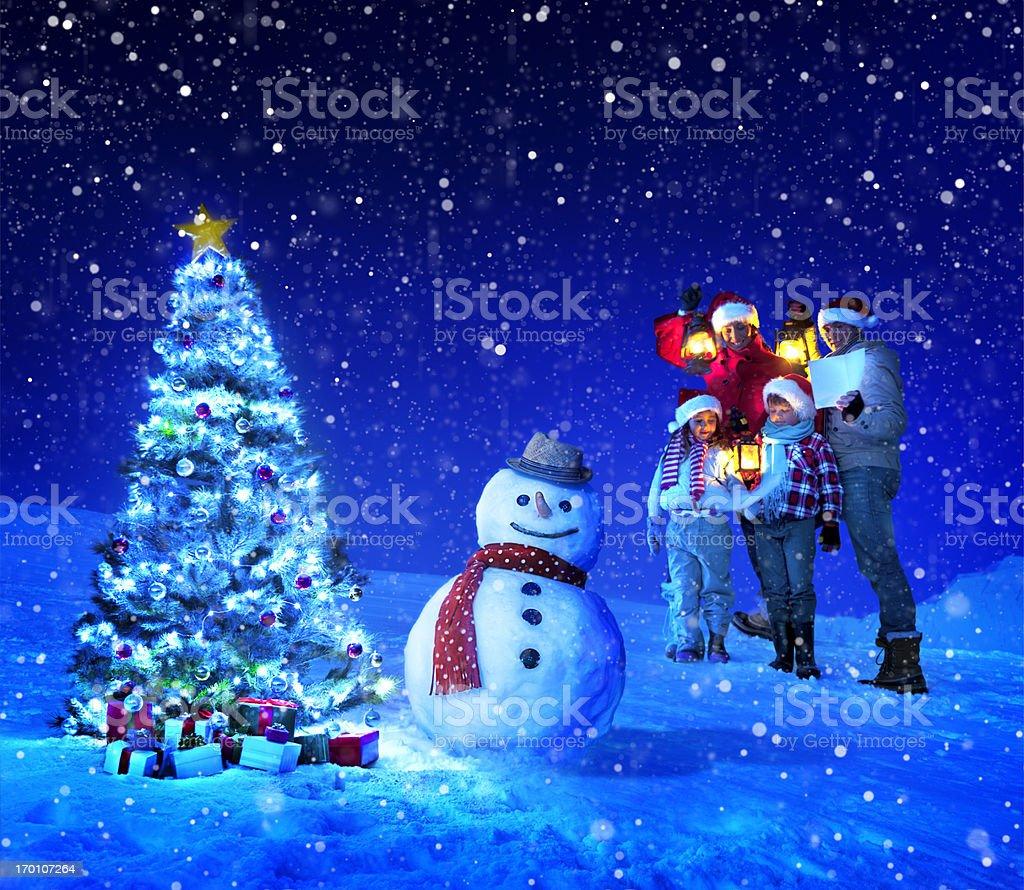 Christmas family Carol Singing royalty-free stock photo