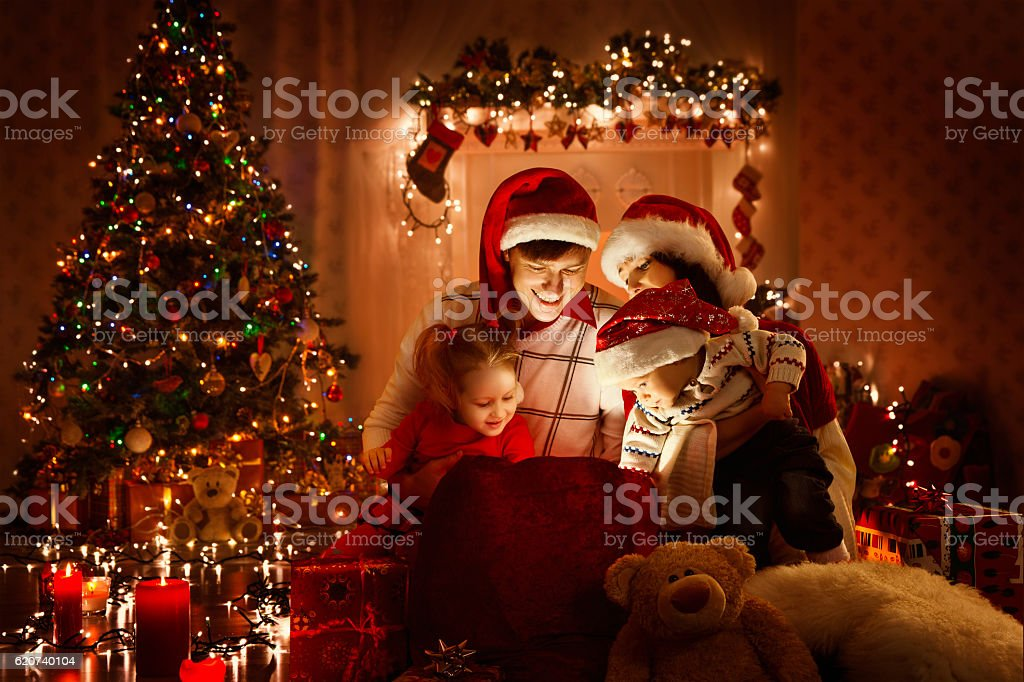 Christmas Family Opening Present Gift Bag, Looking Light, Xmas Tree stock photo