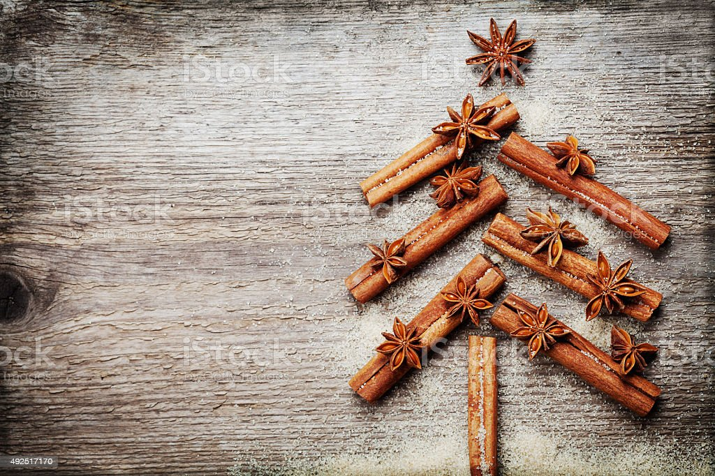 Christmas fir tree made from spices cinnamon sticks, anise star stock photo