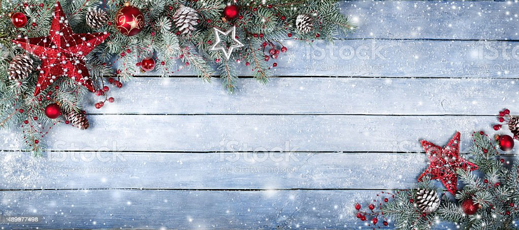 Christmas Fir Tree On Wooden Background With Snowflakes stock photo