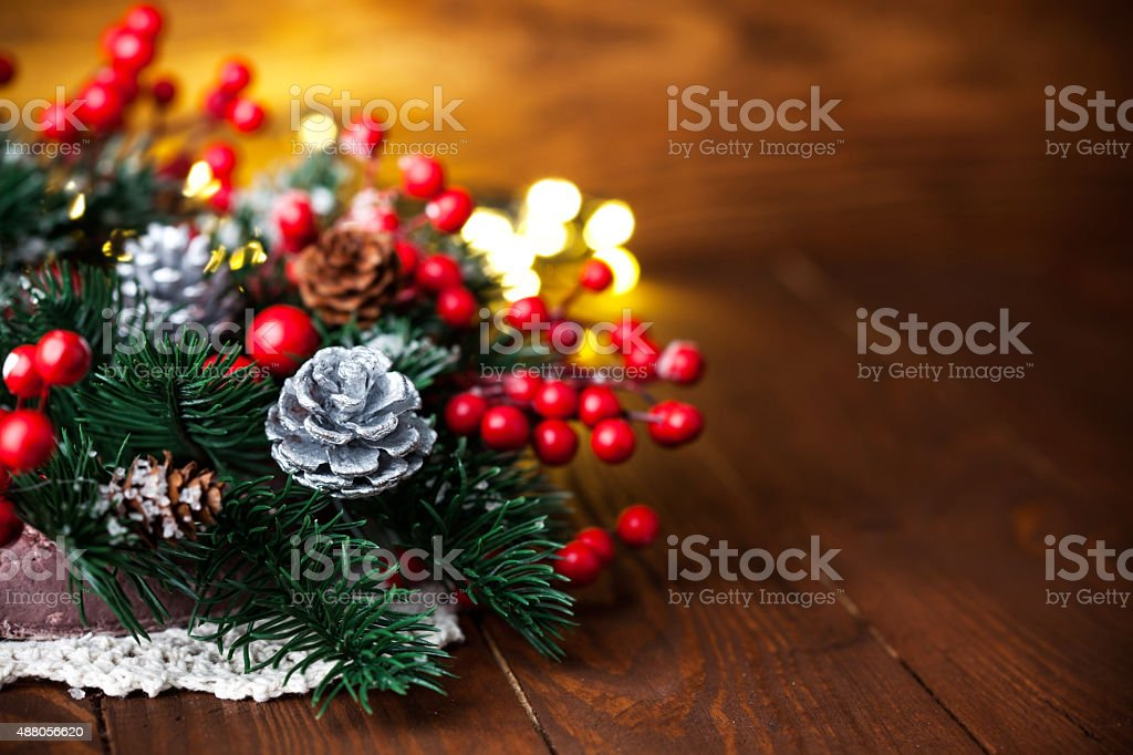 Christmas fir with pinecone and garland stock photo