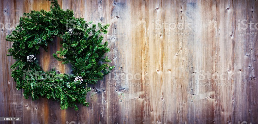 Christmas fir wreath on wooden background. Toned image. stock photo