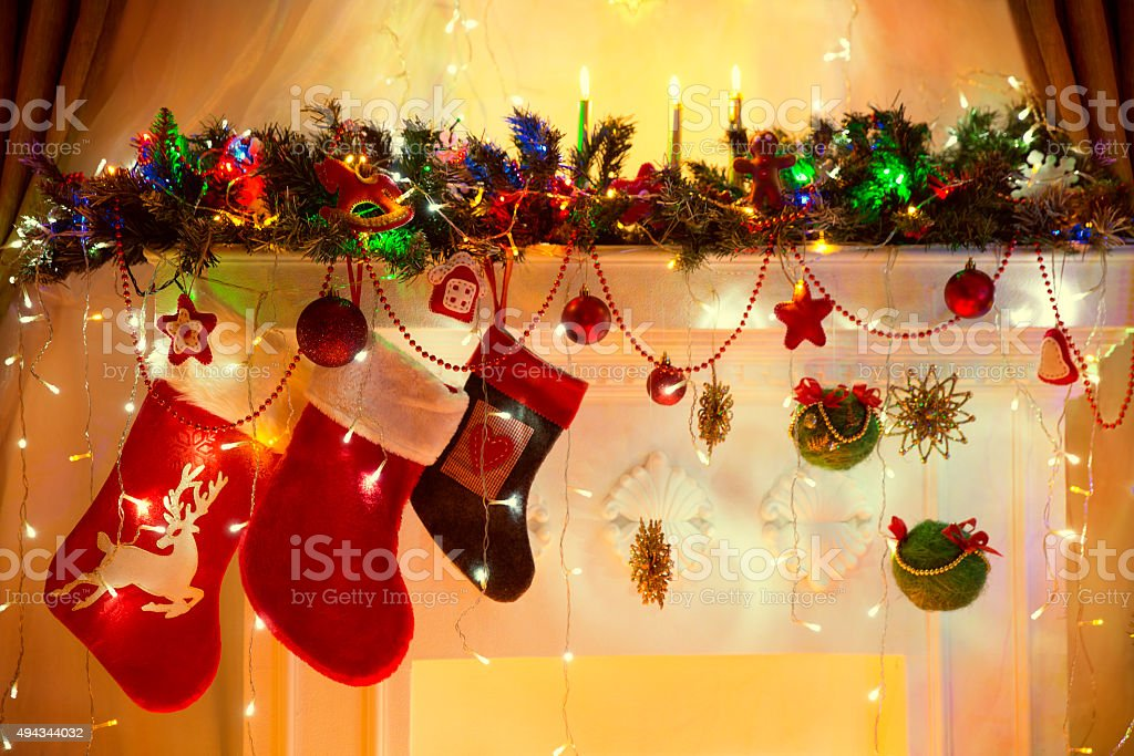 Christmas Fireplace, Family Hanging Socks, Xmas Lights Decoration, Tree Branches stock photo