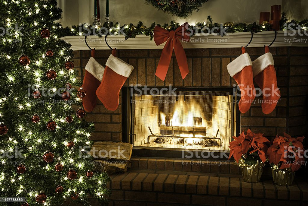 Christmas fireplace, tree, and decorations stock photo