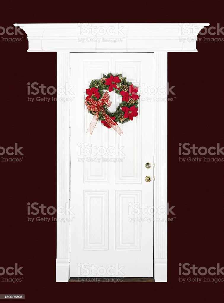 Christmas flower wreath on white door royalty-free stock photo
