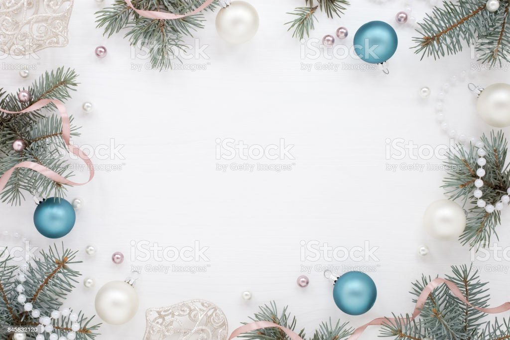 Christmas frame, blue pearly balls, fir, white texture stock photo