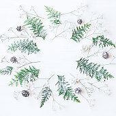 Christmas frame made of pine cones, thuja branches, gypsophila flowers