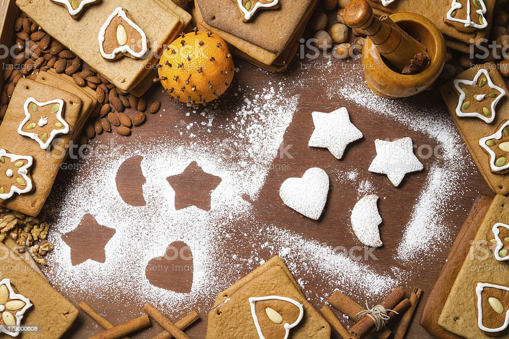 Christmas frame made up of gingerbread cookies and nuts royalty-free stock photo
