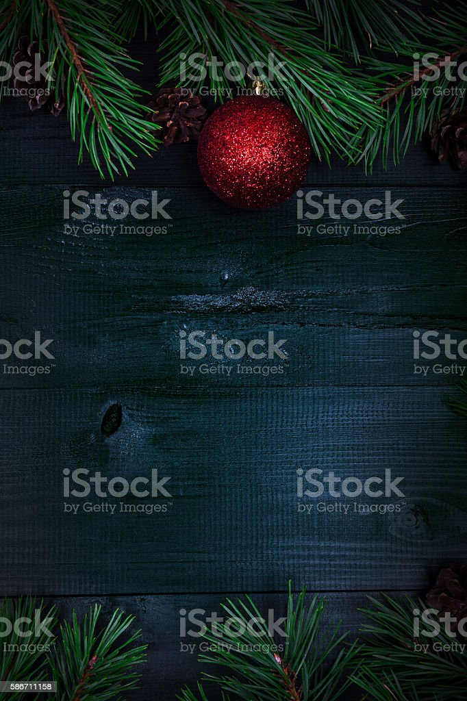 Christmas frame with fir twigs and baubles stock photo