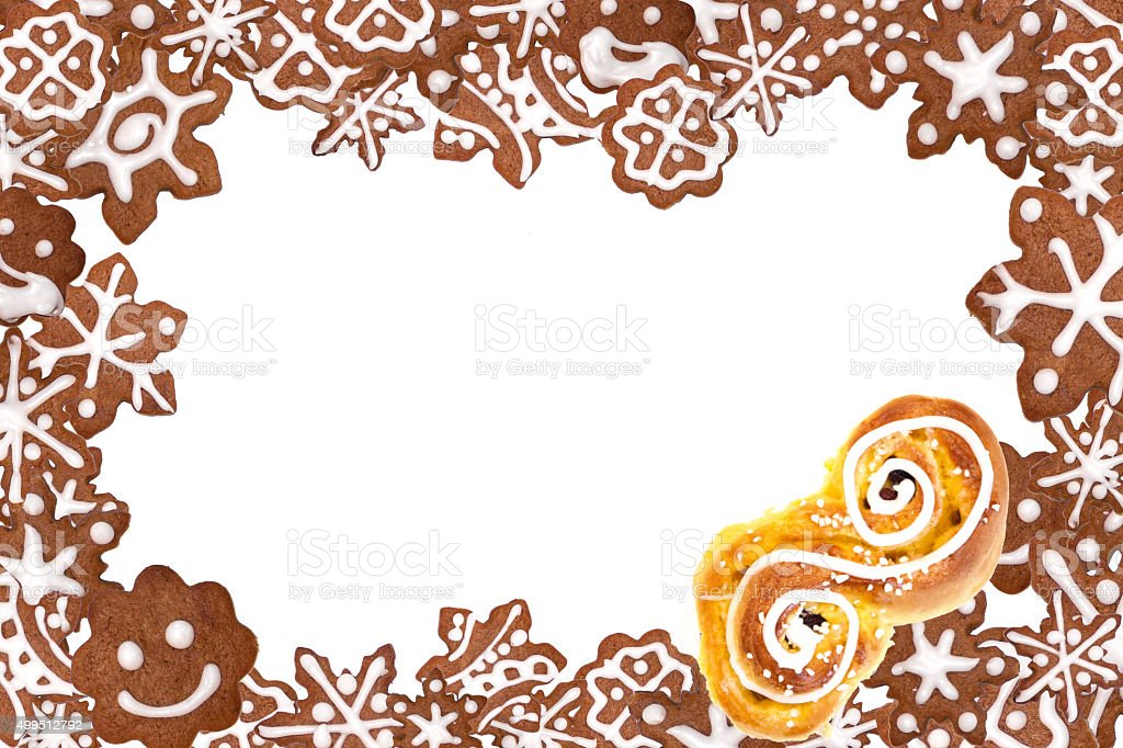 Christmas frame with gingerbread cookies and saffron bun. stock photo