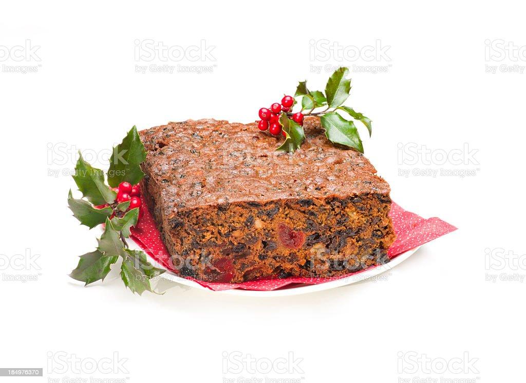 Christmas Fruit Cake and Holly. stock photo