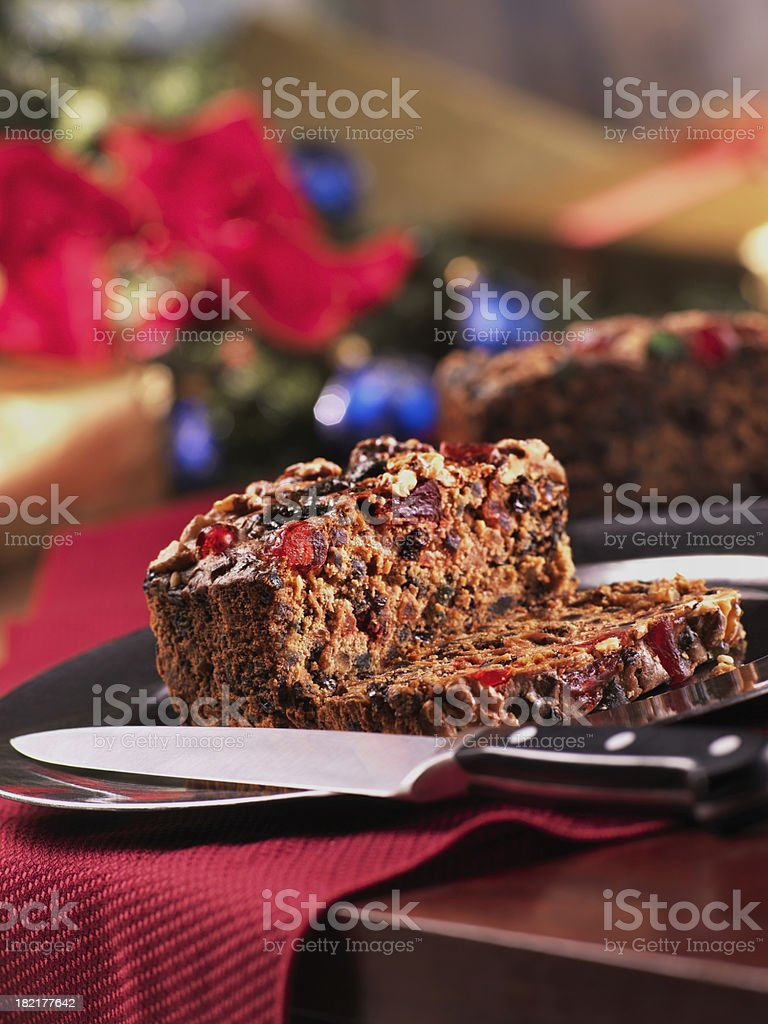 Christmas Fruit Cake cut with Knife stock photo