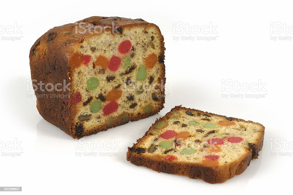 A Christmas fruit cake with one slice cut stock photo