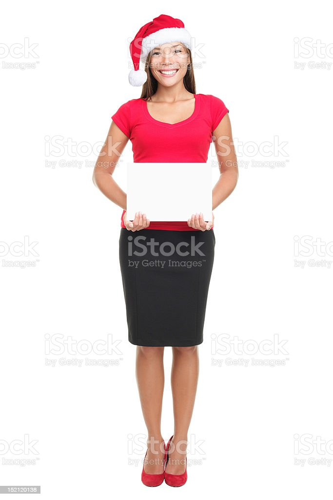 Christmas full length businesswoman showing blank sign isolated on white royalty-free stock photo