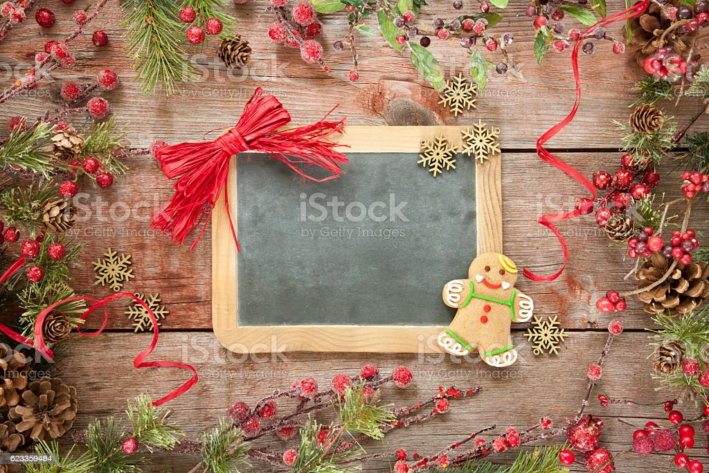 Christmas Garland Frame with Gingerbread Man on Old Wood Background stock photo