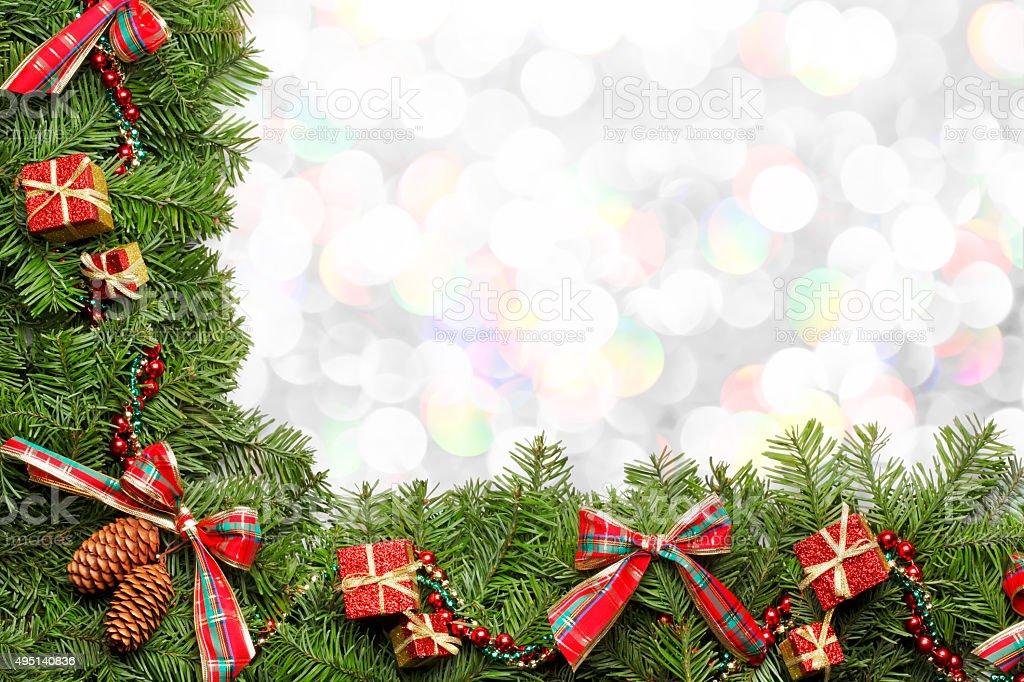 Christmas Garland Frames Blurred Christmas Lights stock photo