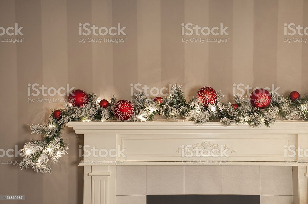 Christmas Garland on Fireplace stock photo