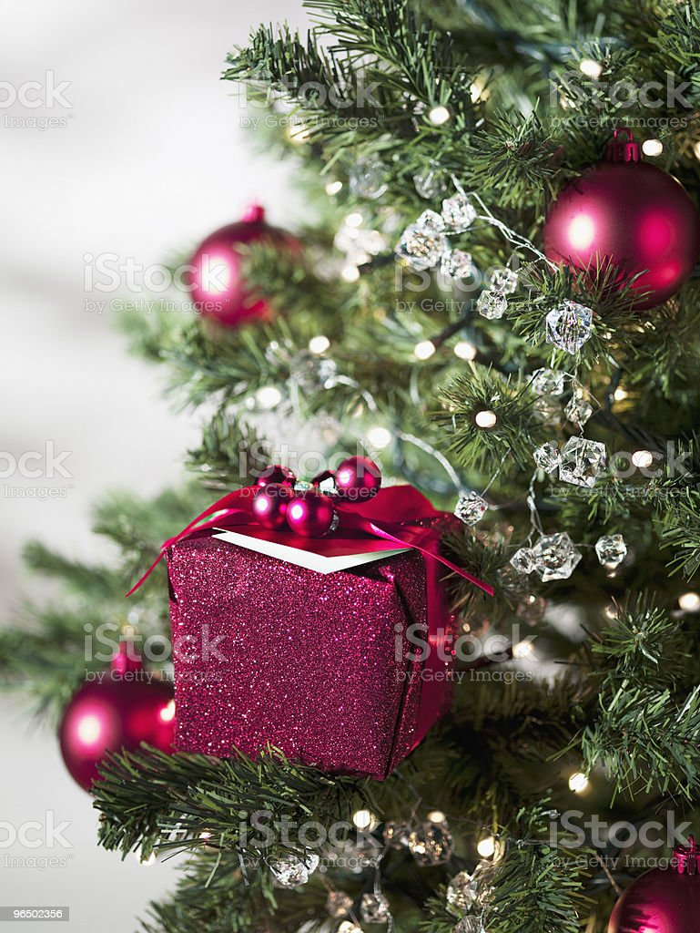 Christmas gift and ornaments on tree stock photo