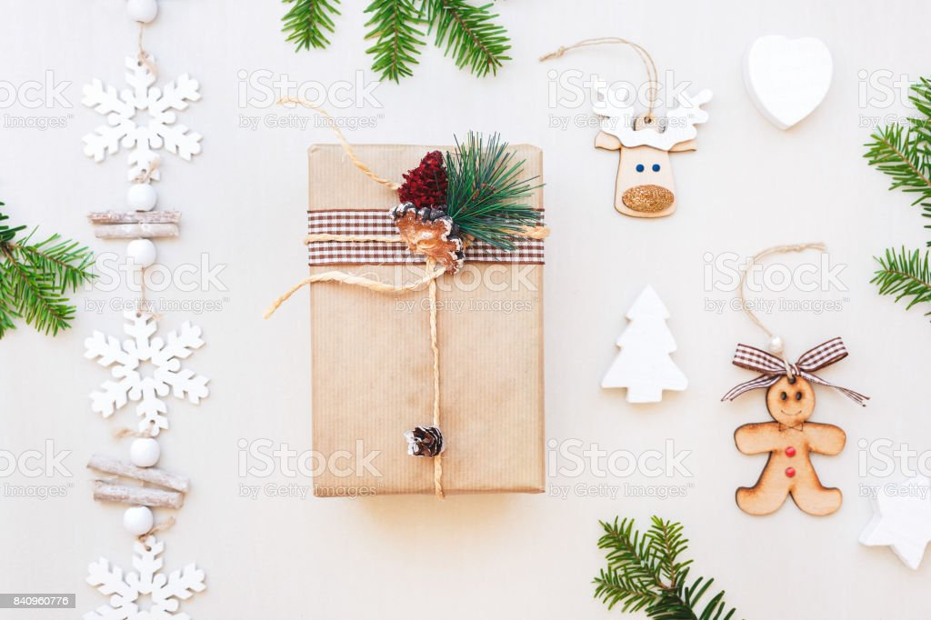 Christmas gift and ornaments on white table. Flat lay, top view