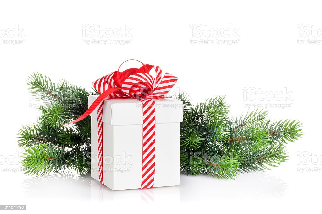 Christmas gift box and fir tree branch stock photo
