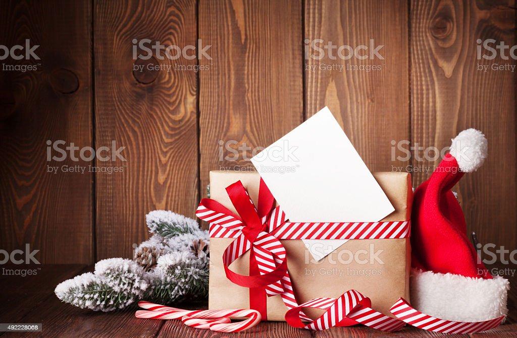 Christmas gift box and santa hat stock photo