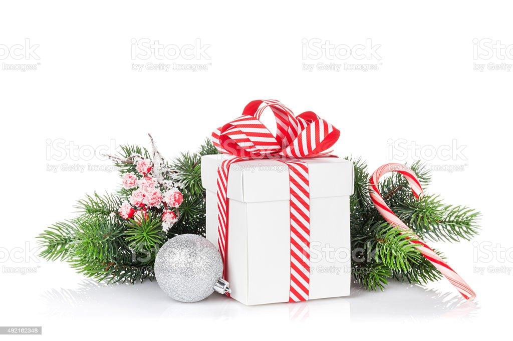 Christmas gift box and tree branch stock photo