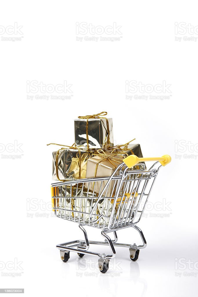 Christmas Gift Box in Shopping Cart royalty-free stock photo