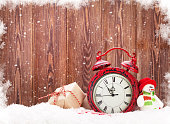 Christmas gift box, snowman toy and alarm clock
