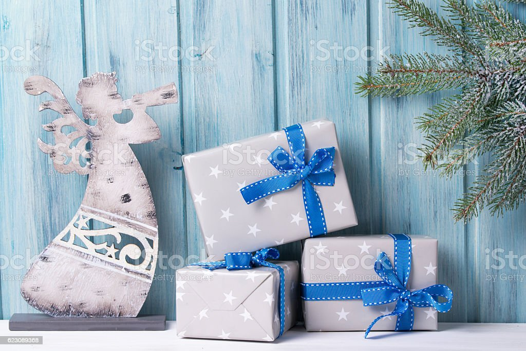 Christmas gift boxes and angel, fir tree with snow stock photo
