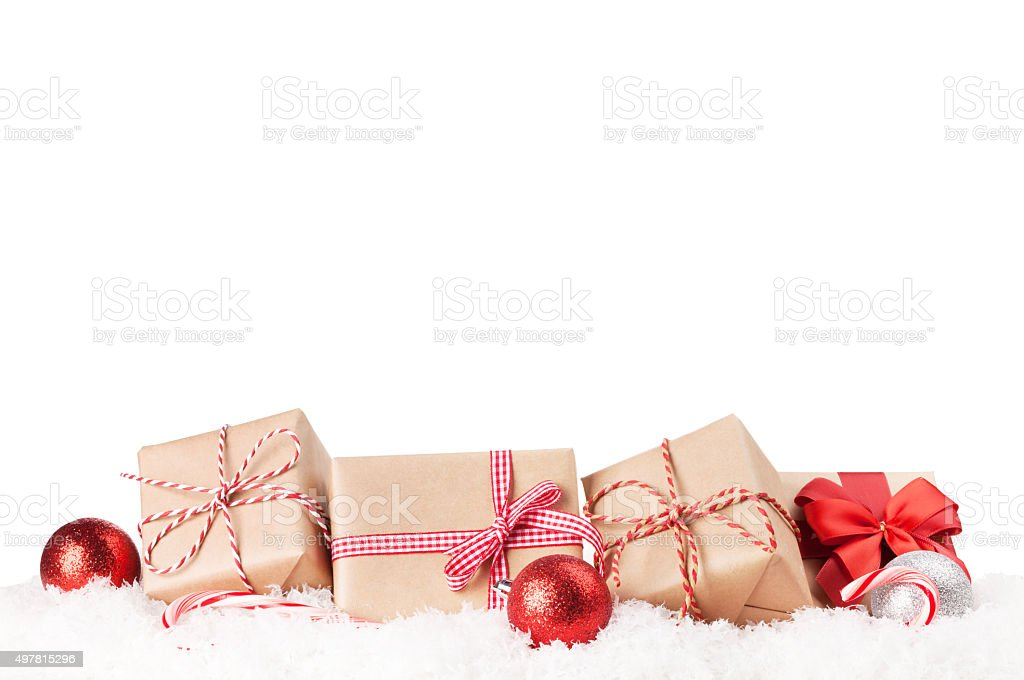 Christmas gift boxes and decor in snow stock photo