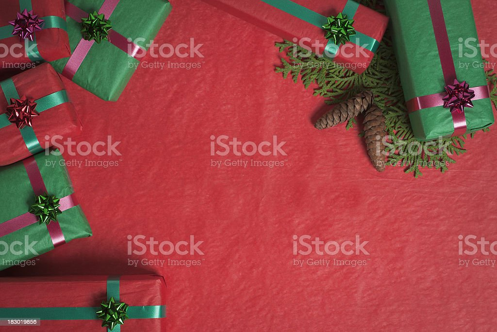 Christmas Gift Boxes on Red with Cedar stock photo