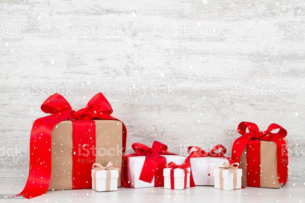 Christmas Gift Boxes on White Wooden Background stock photo