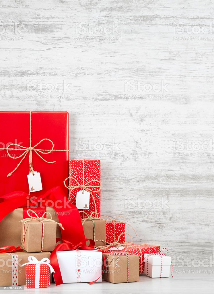 Christmas Gift Boxes on Wooden Background stock photo