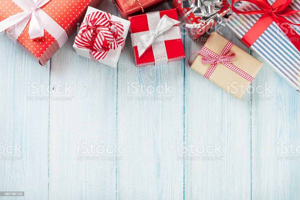 Christmas gift boxes on wooden table stock photo