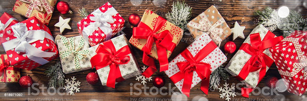 Christmas gift boxes placed on wooden planks stock photo