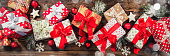 Christmas gift boxes placed on wooden planks