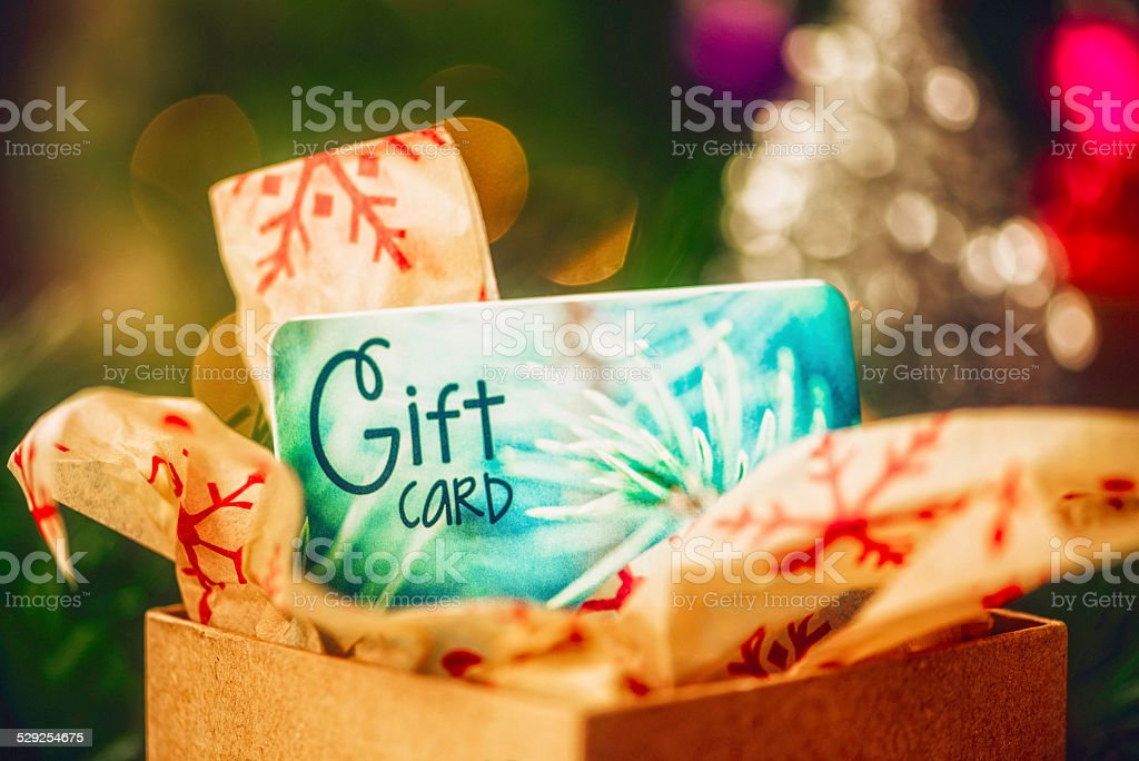 Christmas gift card in opened box in Christmas setting stock photo
