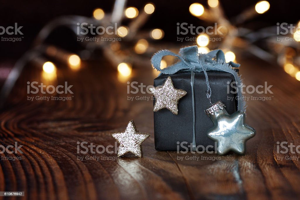 Christmas gift in front of festive background stock photo