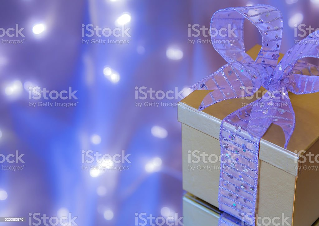 Christmas gift in silver and gold with blue background (P) stock photo