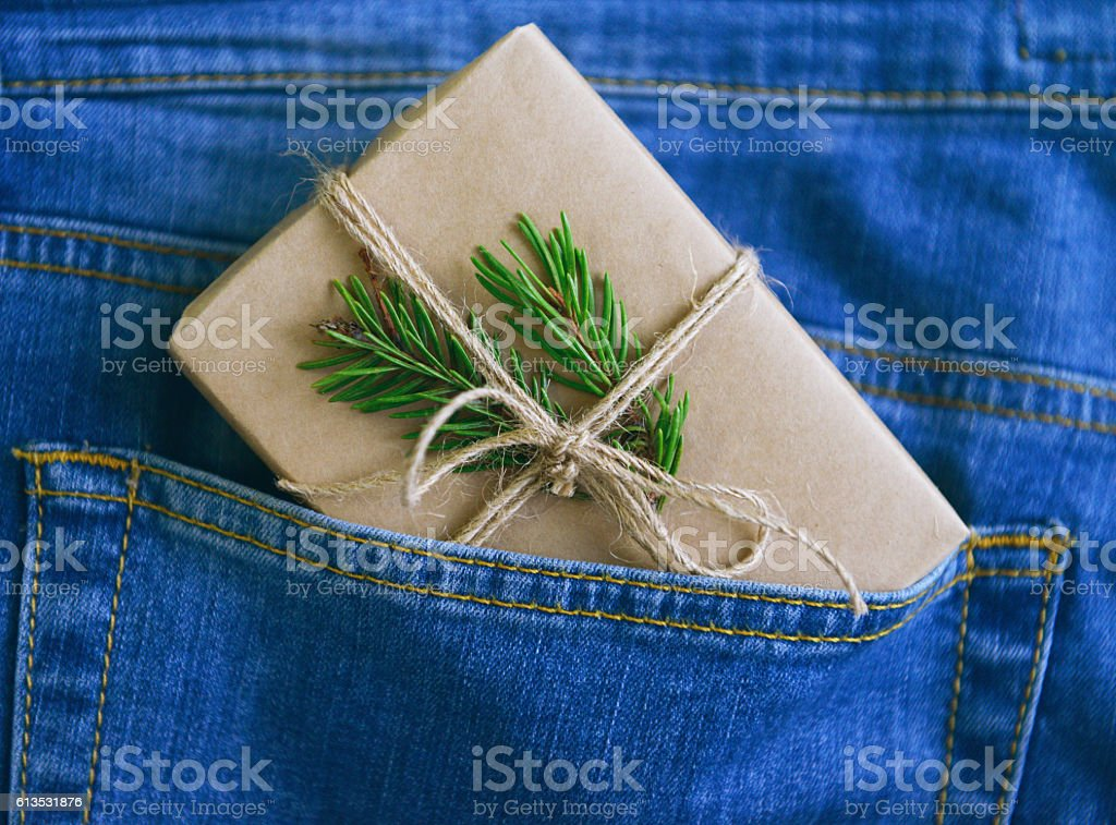Christmas gift in the pocket of jeans stock photo