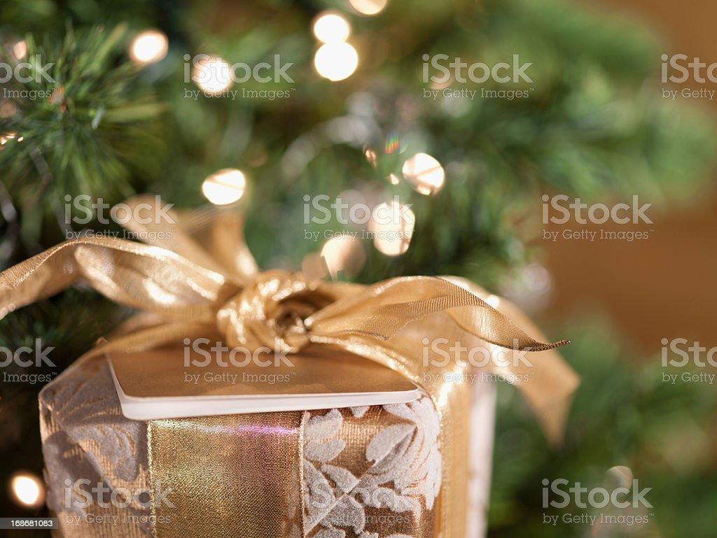 Christmas gift near tree royalty-free stock photo
