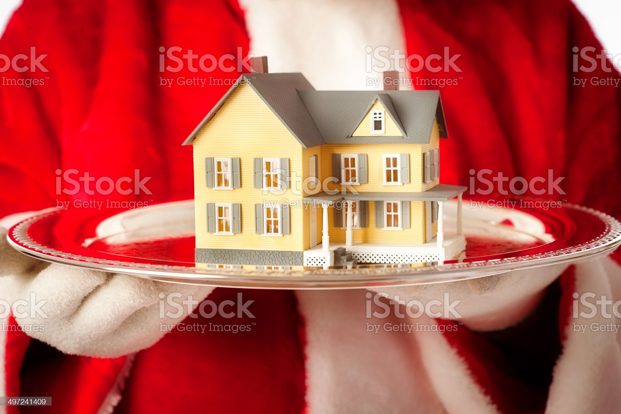 Christmas Gift of Real Estate Residential Home by Santa Clause royalty-free stock photo