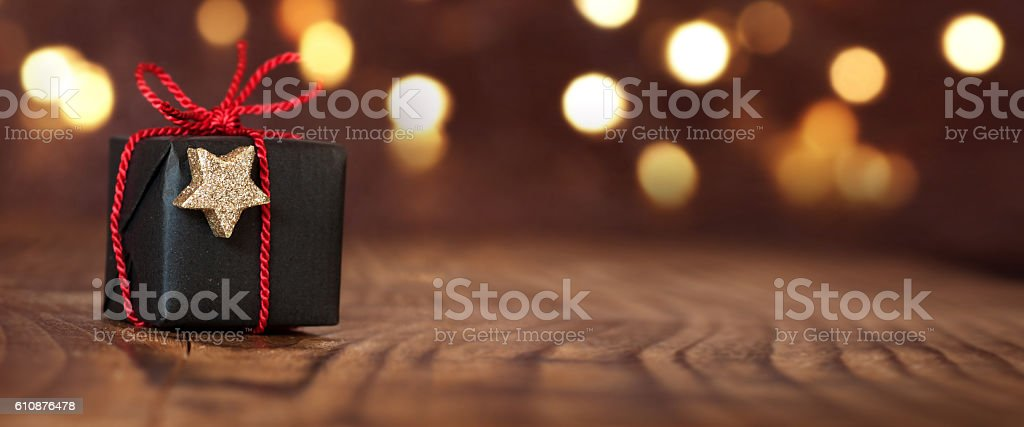 Christmas gift on an empty table stock photo