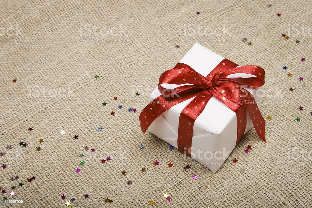 Christmas gift on burlap background. royalty-free stock photo