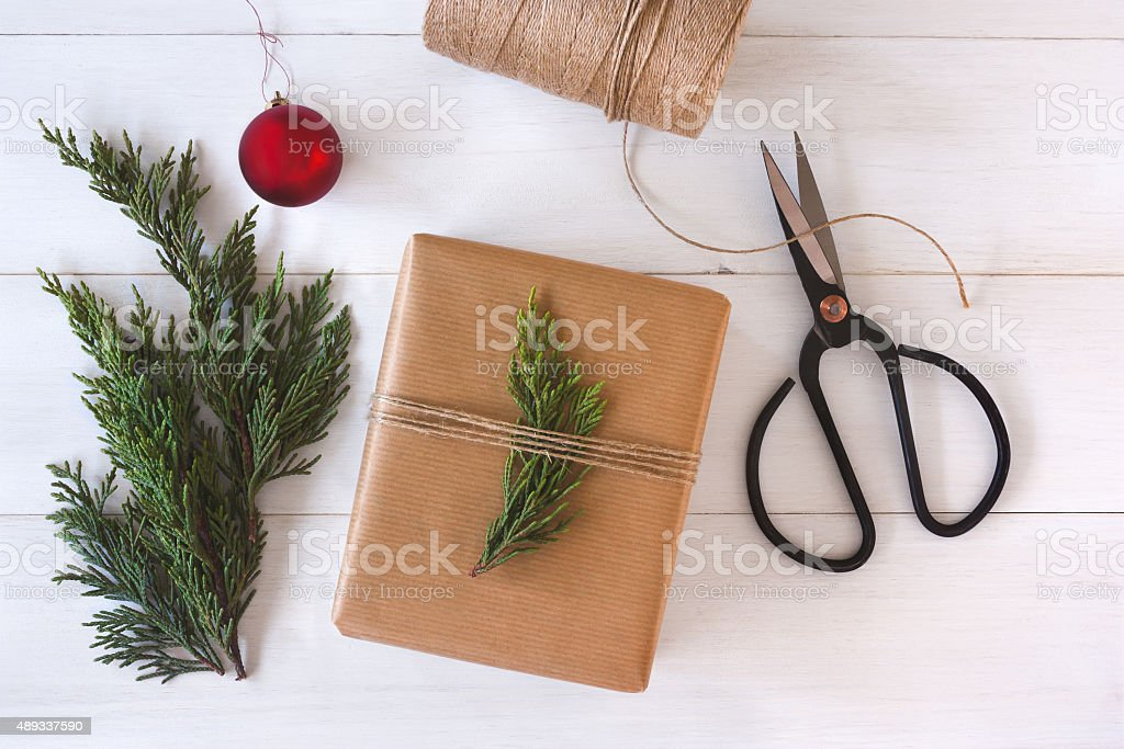 Christmas gift on white wooden background stock photo