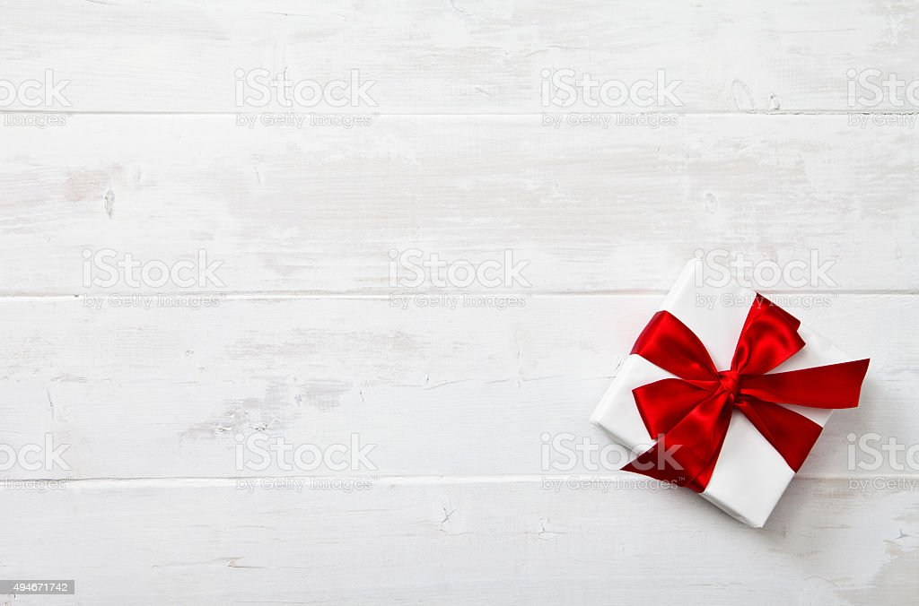 Christmas Gift on a barn board background. Copy space.
