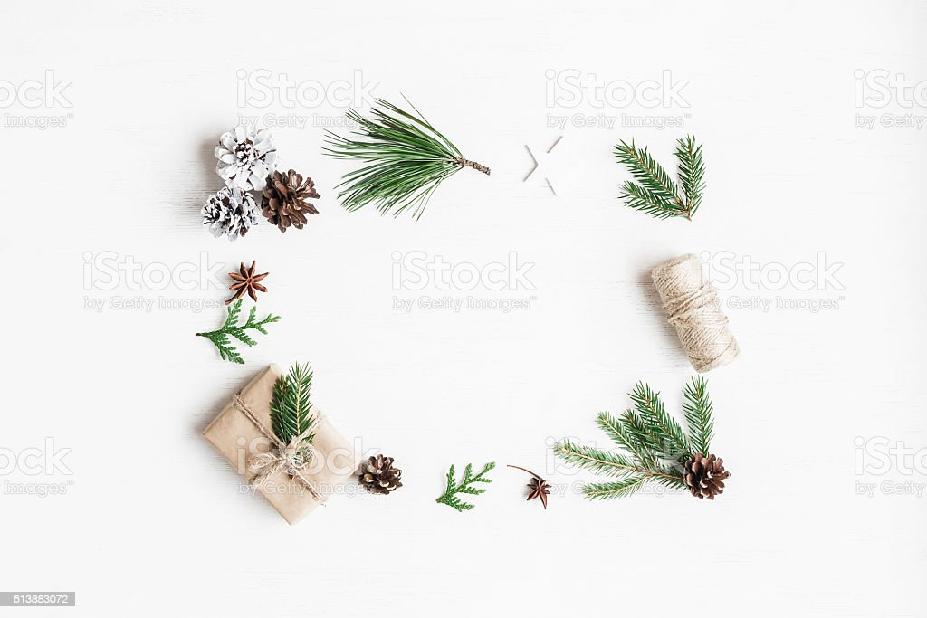 Christmas gift, pine cones, fir branches. Top view, flat lay stock photo