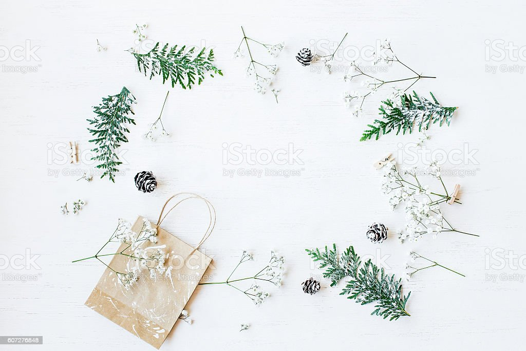 Christmas gift, pine cones, thuja branches and gypsophila flowers.Flat lay stock photo