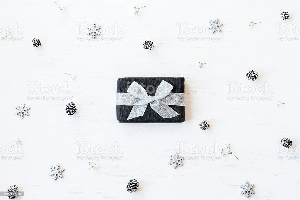 Christmas gift, snowflakes, pine cones and gypsophila flowers stock photo